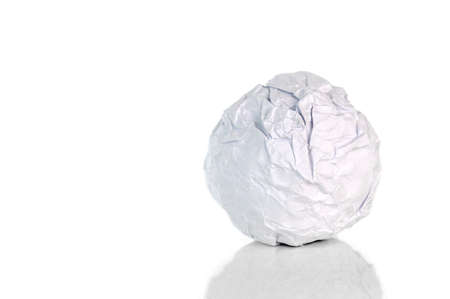 Crumpled paper ball on white Imagens