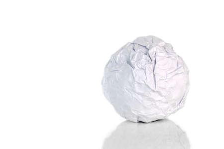 Crumpled paper ball on white Stockfoto