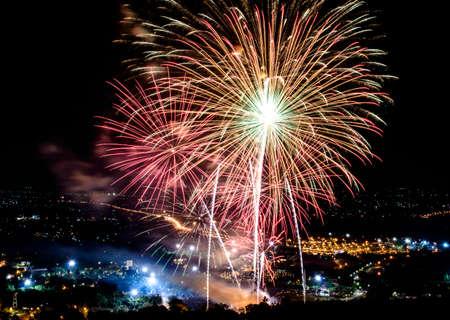 Fireworks on night city background Stock Photo