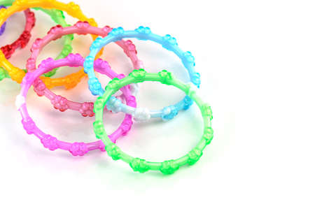colorful plastic toy bangle on white background photo