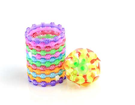 bangle: colorful plastic toy bangle on white background Stock Photo