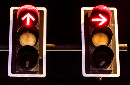 Red traffic lights on night background photo