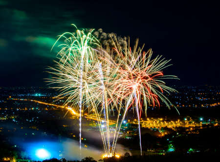 fires artificial: Fireworks on night city background Stock Photo