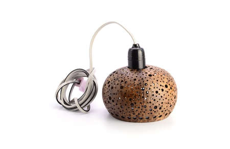 Lamp made from coconut shells on white background