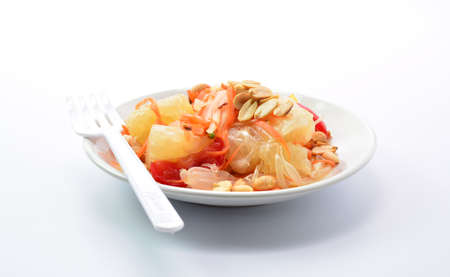 exotic food: pomelo and salad on white background