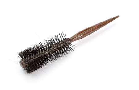 comb hair: hair loss with comb on white blackgroud