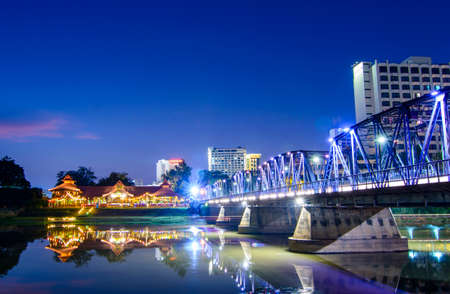 architecture alphabet: Iron bridge At twilight time Chiangmai in Thailand , With Lens Flare