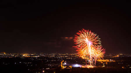 firework display: Beautiful firework display for celebration with city at night Stock Photo