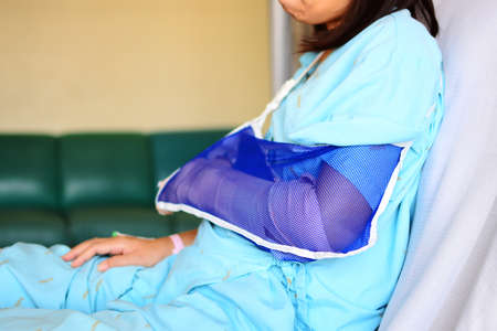 elbow brace: An injured arm from accident with arm sling
