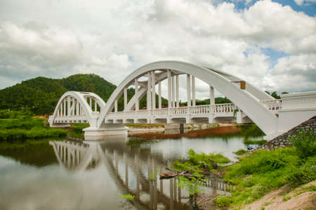 lamphun: white railway bridge constructed on cloudy days at Lamphun, Thailand. Stock Photo