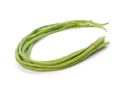 long beans: bundle of fresh long beans isolated on a white background