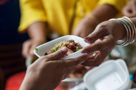 Feeding the poor to help and share Stock Photo