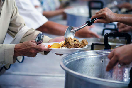 Donate food to hungry people, Concept of poverty and hunger 免版税图像