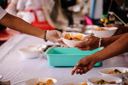 Donate food to hungry people, Concept of poverty and hunger Stock Photo