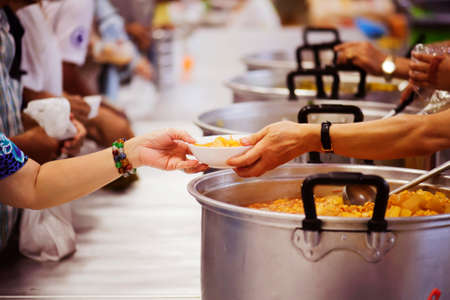 Hands-on food of the hungry is the hope of poverty : concept of homelessness Stock Photo