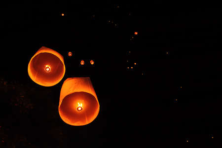 Loy Krathong Festival in Thailand is floating in the night sky.