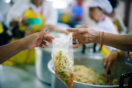The poor have been sharing food  to Relieve Hunger : The Concept of Feeding Stock Photo