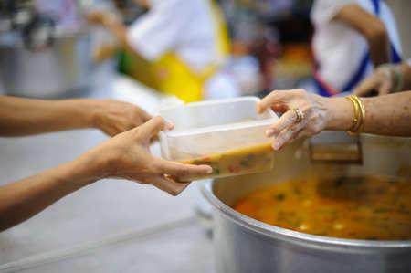 Free food for the poor and Food distribution Stock Photo