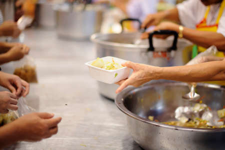 Charity food is free for people in slums. Stock Photo
