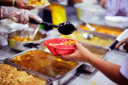 Volunteers have been feeding the homeless, They reach out with love and concern. Stock Photo