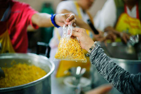 Volunteers are giving food to the homeless poor :  the concept of humane