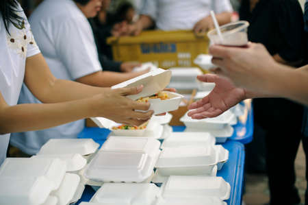 poverty concept : Help with feeding homeless people to alleviate hunger.