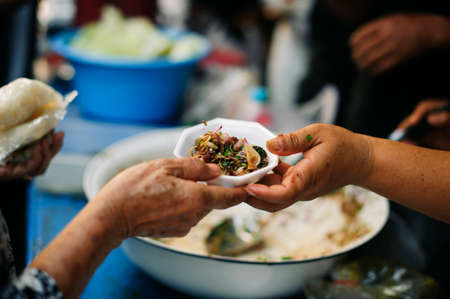 Feeding the poor Helping each other in society : Giving concept Stock Photo