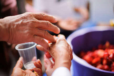feeding to hand the poor helping  beggar in social. poverty concept Stock Photo