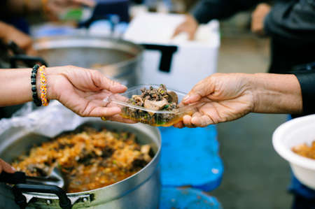Give concept : feeding the poor to alleviate hunger.