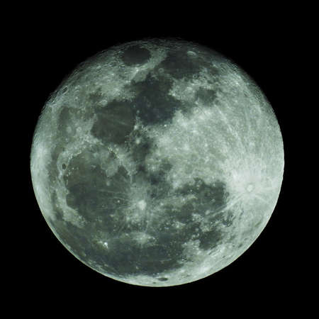 The moon shines on a black background.