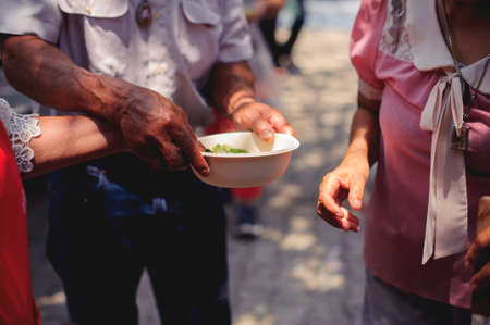 The Hope of the Poor by Donating Charity Food to the Immaculate : Participation in sharing food for the poor : The Concept of Love : The beggar is waiting for food from charity aid