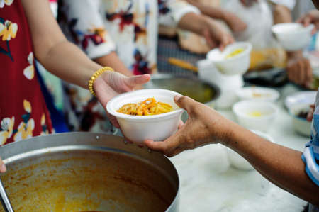 Food sharing in human societies can help homeless people : concept Sharing Food With Homeless