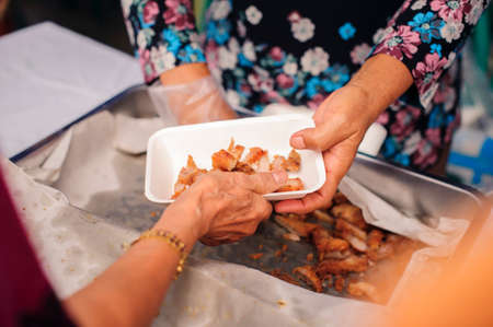 concept of poverty in Asian society : Charity food is free for people in slums Stock Photo - 126878642