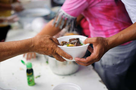 concept Tackling Hunger and Food : Donate food to the poor and the poor who suffer from starvation Stockfoto