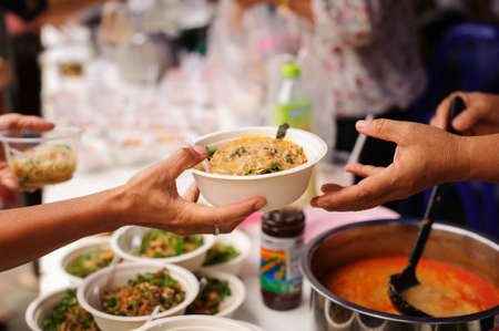 concept of poverty in Asian society : Charity food is free for people in slums Stock Photo - 126878751