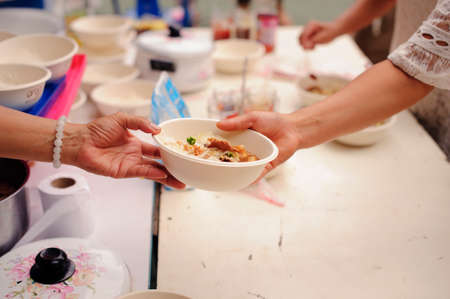concept of poverty in Asian society : Charity food is free for people in slums Stock Photo - 126878761