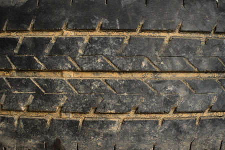 The texture of the used rubber tire. Car tire tread pattern Banco de Imagens