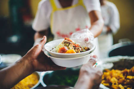 Helping people with food donations, alleviating hunger and hunger : concept of poverty