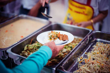 Food needs of the poor in Asia : beggars are asking for food from charitable food service providers 版權商用圖片