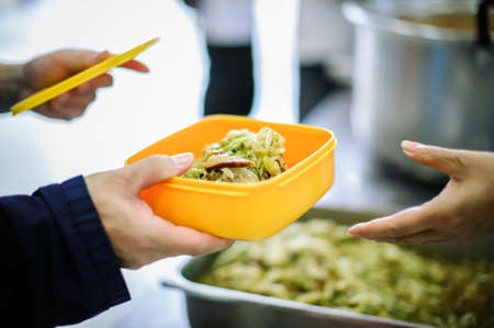 Difficult people receive free food from philanthropy through volunteers: concept of feeding and sharing 스톡 콘텐츠
