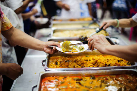 Food Sharing Society: Volunteers are sharing food to hungry people in society.