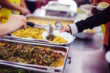 The poor need free food: Charitable food donations to needy beggars