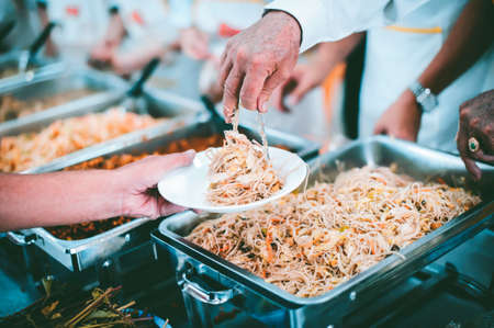 Donate food to the poor : concept Sharing Food With Homeless Фото со стока