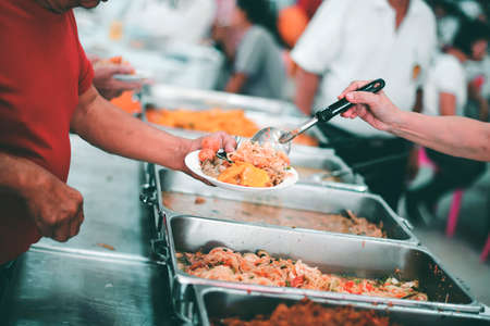 Free food for poor and homeless : Food concept of hope Фото со стока