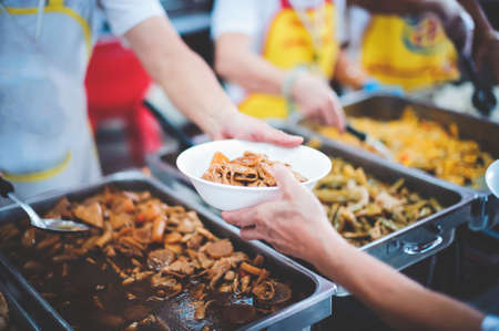 Charity food concept : Volunteers Share Food to the Poor to Relieve Hunger