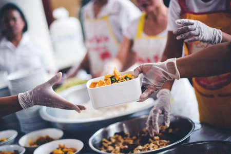 Donate food to the poor : Poverty concept