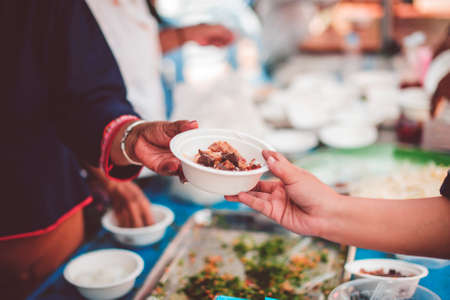 Concept of feeding and sharing : Providing free food for the poor hunger