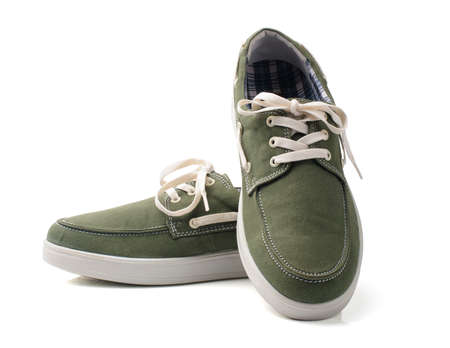 Light green fashion canvas shoes on white background