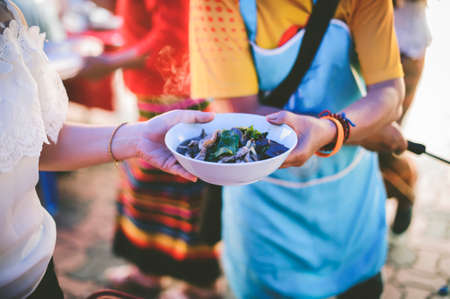 Volunteers Share Food to the Poor to Relieve Hunger: Charity food concept