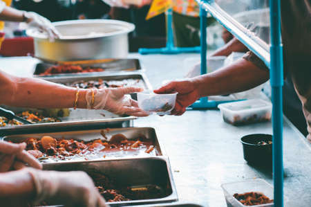 Sharing Food to Homeless and the Poor: The Concept of Feeding Фото со стока
